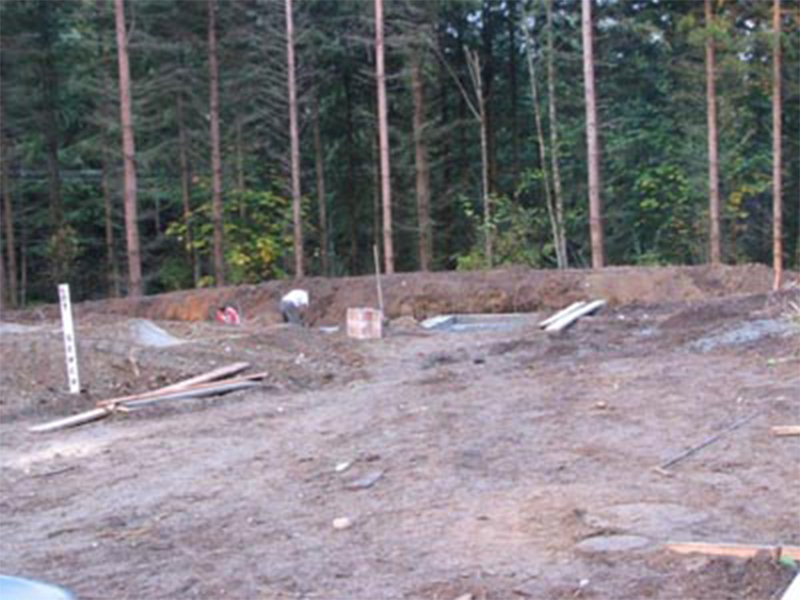 Tulalip Housing and Construction Mission Highlands view of lot with trees as well, digging ground for development