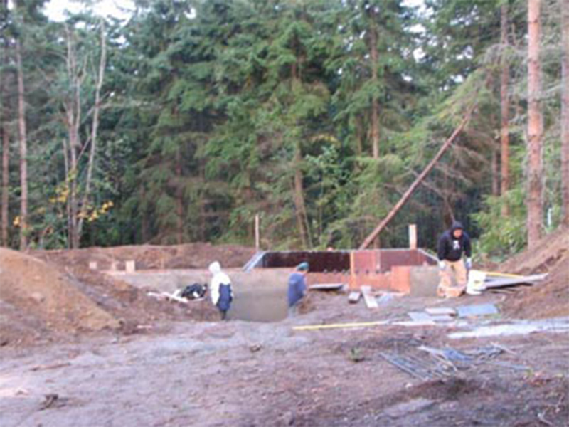 Tulalip Housing and Construction Mission Highlands view of lot with foundation construction commencing.